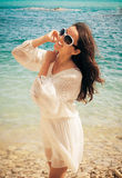 Happy woman in summer white dress on beach. Royalty Free Stock Images