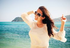 Happy woman in summer white dress on beach. Stock Image