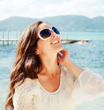 Happy woman in summer white dress on beach. Stock Photography