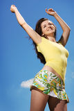 Happy woman in the sun Stock Photography