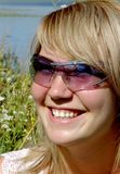 Happy woman in sun glasses Stock Photos