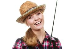 Happy woman in sun hat holding fishing rod Stock Photography