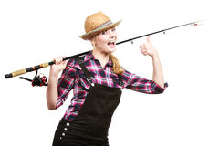 Happy woman in sun hat holding fishing rod Royalty Free Stock Image