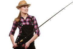 Happy woman in sun hat holding fishing rod. Spinning, angling, cheerful fisherwoman concept. Happy woman in sun hat holding fishing rod, having fun and smiling stock photo