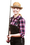 Happy woman in sun hat holding fishing rod. Spinning, angling, cheerful fisherwoman concept. Happy woman in sun hat holding fishing rod, having fun and smiling stock photos