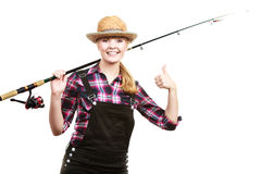 Happy woman in sun hat holding fishing rod. Spinning, angling, cheerful fisherwoman concept. Happy woman in sun hat holding fishing rod, having fun and smiling stock image