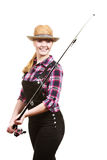 Happy woman in sun hat holding fishing rod. Spinning, angling, cheerful fisherwoman concept. Happy woman in sun hat holding fishing rod, having fun and smiling royalty free stock photos