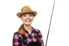 Happy woman in sun hat holding fishing rod. Spinning, angling, cheerful fisherwoman concept. Happy woman in sun hat holding fishing rod, having fun and smiling stock images