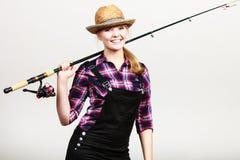 Happy woman in sun hat holding fishing rod Stock Photo