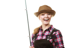 Happy woman in sun hat holding fishing rod Stock Images