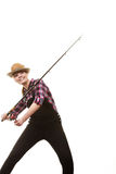 Happy woman in sun hat holding fishing rod. Spinning equipment, angling, cheerful fisherwoman concept. Happy woman in sun hat holding fishing rod, having fun royalty free stock photo