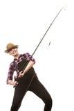 Happy woman in sun hat holding fishing rod. Spinning equipment, angling, cheerful fisherwoman concept. Happy woman in sun hat holding fishing rod, having fun stock image
