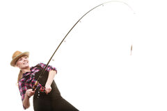 Happy woman in sun hat holding fishing rod. Spinning equipment, angling, cheerful fisherwoman concept. Happy woman in sun hat holding fishing rod, having fun royalty free stock images