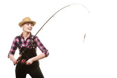 Happy woman in sun hat holding fishing rod. Spinning equipment, angling, cheerful fisherwoman concept. Happy woman in sun hat holding fishing rod, having fun royalty free stock photography