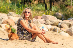Happy woman sun tanning and relaxing on beach. Royalty Free Stock Photography