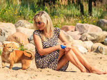 Happy woman sun tanning and relaxing on beach. Royalty Free Stock Images