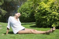 Happy woman sunbathing stock photos