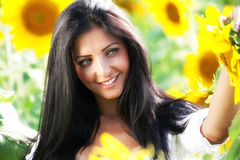Happy woman in sunflower field Royalty Free Stock Photos