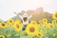 Happy woman in sunflower field smiling with happiness. Due to healthy food. Happy people, health care and agriculture business concept. Happy farmer or farm Royalty Free Stock Photo
