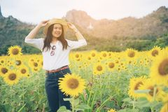 Happy woman in sunflower field smiling with happiness. Due to healthy food. Happy people, health care and agriculture business concept. Happy farmer or farm Royalty Free Stock Photography