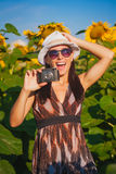 Happy woman in a sunflower's field Royalty Free Stock Images