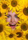 Happy woman with sunflowers Royalty Free Stock Photos
