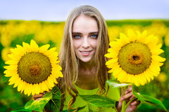 Happy woman with sunflowers outdoors Royalty Free Stock Image