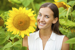 Happy woman with sunflowers Stock Photo