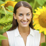 Happy woman with sunflowers Royalty Free Stock Image