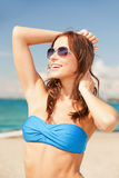 Happy woman in sunglasses on the beach. Picture of happy woman in sunglasses on the beach Royalty Free Stock Photography
