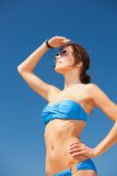 Happy woman in sunglasses on the beach. Picture of happy woman in sunglasses on the beach Royalty Free Stock Photos