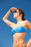 Happy woman in sunglasses on the beach Royalty Free Stock Images