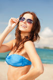 Happy woman in sunglasses on the beach. Picture of happy woman in sunglasses on the beach Stock Photo
