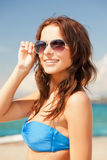 Happy woman in sunglasses on the beach Stock Photo