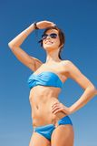 Happy woman in sunglasses on the beach. Picture of happy woman in sunglasses on the beach Stock Image