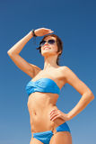 Happy woman in sunglasses on the beach. Picture of happy woman in sunglasses on the beach Royalty Free Stock Photo