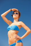 Happy woman in sunglasses on the beach Stock Images