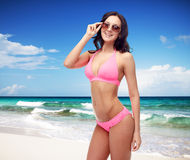 Happy woman in sunglasses and bikini swimsuit Royalty Free Stock Photo