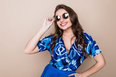 Happy young woman in sunglasses looking excited look at the camera on color studio background. Body language royalty free stock images