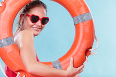 Happy woman in sunglasses with ring buoy lifebuoy. Royalty Free Stock Images