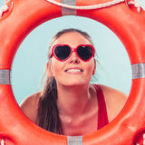 Happy woman in sunglasses with ring buoy lifebuoy. Stock Photo