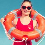 Happy woman in sunglasses with ring buoy lifebuoy. Stock Photos