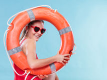 Happy woman in sunglasses with ring buoy lifebuoy. Stock Images