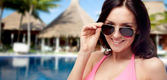 Happy woman in sunglasses and swimsuit on beach Stock Photography