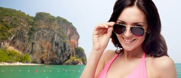 Happy woman in sunglasses and swimsuit Royalty Free Stock Photo