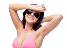 Happy woman in sunglasses and swimsuit Royalty Free Stock Image