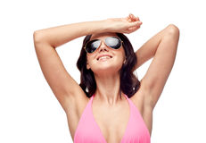Happy woman in sunglasses and swimsuit Stock Images