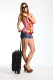 Happy woman in sunglasses waiting with suitcase Stock Photos