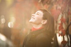 Happy woman in sunlight Stock Photo