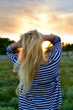 Happy woman in sunlight. Royalty Free Stock Photo